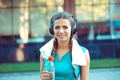 Woman is ready for outdoor workout, holding bottle of water royalty free stock image