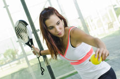 Woman ready for paddle tennis serve Stock Images