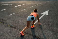 Woman ready for running on asphalt Royalty Free Stock Images