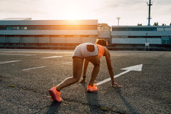 Woman ready for running at sunset in the city Stock Image