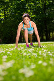 Woman ready for running training in park Royalty Free Stock Photo
