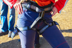 The woman is ready to belay climber Royalty Free Stock Photo