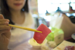 Woman ready to eat sashimi Stock Photos
