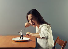 Woman ready to eat small scared man Stock Photos