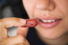 Woman ready to eat smoked sausages. Stock Images
