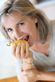Woman ready to eat yellow pear stock images