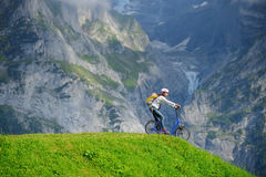 A woman ready to go down from hill by kick scooter at Bort stati. On, Grindelwald Switzerland Stock Photos