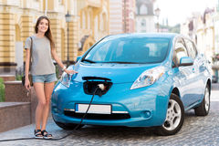 Woman ready to go on electric vehicle Stock Image
