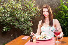 Woman ready to have lunch and wine on terrace Stock Photos