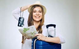 Woman ready to holiday with camera, paper map. Young woman ready to holiday with camera, paper map and suitcase Stock Images