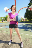 Woman ready to play basketball on the playground Royalty Free Stock Photography