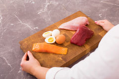 Woman ready to prepare nutritious dinner Stock Images