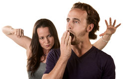 Woman Ready to Punch Yawning Man Royalty Free Stock Image