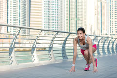 Woman ready to run. Athlete runs and makes the workout. Athletic Royalty Free Stock Photos