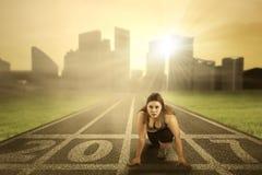 Woman ready to run on start line Royalty Free Stock Photos