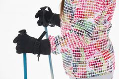 Woman ready to ski with sticks and gloves. Winter. Sports Stock Photo