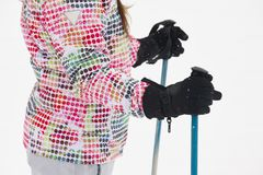 Woman ready to ski with sticks and gloves. Winter. Sports Stock Image