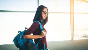Woman ready to travel. Asian woman in airport ready to get on plane and have a trip of travel and adventure Royalty Free Stock Images