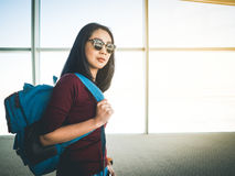 Woman ready to travel. Asian woman in airport ready to get on plane and have a trip of travel and adventure Royalty Free Stock Photography