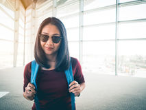 Woman ready to travel. Asian woman in airport ready to get on plane and have a trip of travel and adventure Royalty Free Stock Photo