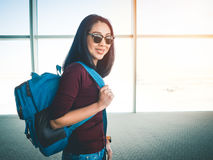 Woman ready to travel. Asian woman in airport ready to get on plane and have a trip of travel and adventure Stock Photos