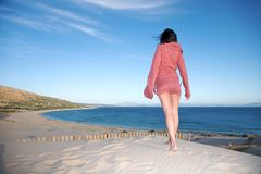 Woman ready to valdevaqueros bay Stock Photo