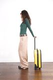 Woman ready with yellow suitcase Royalty Free Stock Images