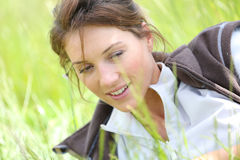 Woman realxing in grass Royalty Free Stock Photography