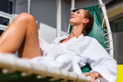 Woman realxing on lounger in spa Royalty Free Stock Image