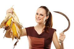 Woman with reaping hook and corn Royalty Free Stock Photos