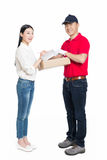 Woman receipt of package delivery Royalty Free Stock Photography