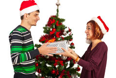 Woman receive Christmas present Royalty Free Stock Image