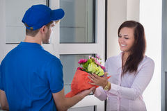 Woman Received Bouquet From Delivery Man Royalty Free Stock Photos