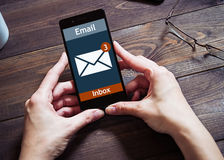The woman received an e-mail online on a mobile phone. Message icon. Royalty Free Stock Photo