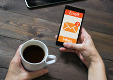 The woman received an e-mail online on a mobile phone. Message icon. Royalty Free Stock Images
