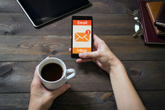 The woman received an e-mail online on a mobile phone. Message icon. Stock Image