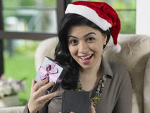 Woman received her christmas present Stock Photography