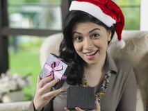 Woman received her christmas present Stock Photos