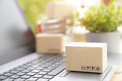Woman received online shopping parcel opening boxes. And buying fashion items and her holding credit card stock image