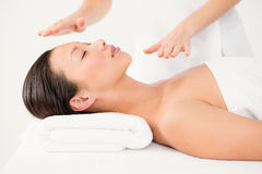 Woman receiving alternative therapy Stock Photo