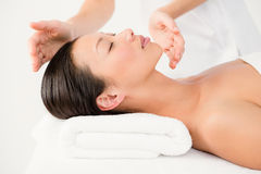 Woman receiving an alternative therapy Royalty Free Stock Images