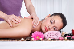 Woman receiving back massage Stock Images