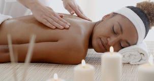 Woman Receiving Back Massage Stock Image