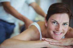 Woman receiving back massage from physiotherapist Royalty Free Stock Photos