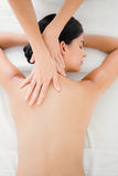 Woman receiving a back massage Stock Images