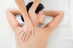 Woman receiving a back massage Stock Image