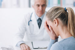 Woman receiving bad news from her doctor Royalty Free Stock Photos