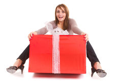 Woman receiving big gift. Young woman receiving big gift isolated on white Royalty Free Stock Images
