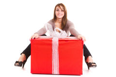 Woman receiving big gift. Young woman receiving big gift on white Royalty Free Stock Photos