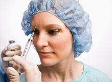 Woman receiving botox injection Royalty Free Stock Photo